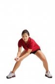 Young woman bending down, waiting for volleyball - Asia Images Group