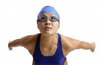 Young woman in swimwear arms stretched behind her, preparing to dive - Asia Images Group