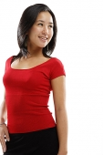 Young woman standing and smiling, looking away - Asia Images Group