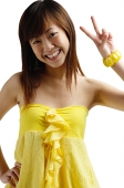 Young woman looking at camera, making hand sign - Asia Images Group