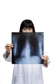 Woman looking at X-ray, obscured face - Asia Images Group