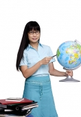 Woman holding globe and pointing at it - Asia Images Group