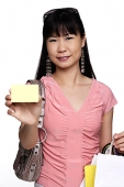 Female shopper holding shopping bags and credit card - Asia Images Group