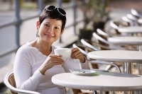 Mature woman in cafe having a drink - Asia Images Group