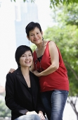 Mother and adult daughter looking at camera - Asia Images Group