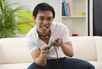 Man playing with video game - Asia Images Group