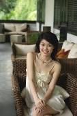 Young woman in sleeveless dress smiling at camera - Asia Images Group