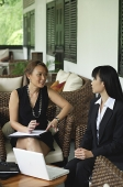 Two businesswomen having a discussion - Asia Images Group