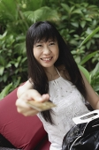 Woman holding out credit card - Asia Images Group