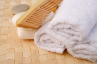 Still life of bath toiletries, comb, bar of soap and towel - Asia Images Group