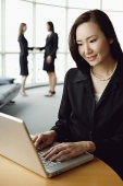 Portrait of businesswoman using laptop - Asia Images Group