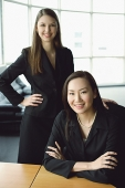 Two businesswomen, looking at camera, portrait - Asia Images Group