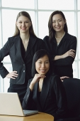 Three businesswomen, smiling at camera, portrait - Asia Images Group