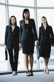 Three businesswomen, walking towards camera - Asia Images Group