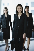 Three businesswomen, smiling at camera - Asia Images Group