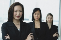 Businesswomen in a row - Asia Images Group