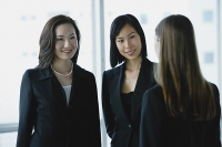 Three businesswomen, talking - Asia Images Group