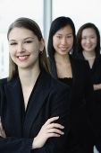 Businesswomen in a row, smiling at camera, Caucasian woman in the front - Asia Images Group