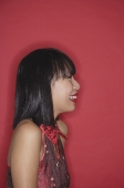 Woman with bob haircut, smiling, side view - Asia Images Group
