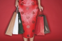 Woman carrying shopping bags - Asia Images Group