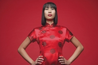 Woman wearing cheongsam, hands on hip - Asia Images Group