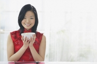 Woman holding bowl of rice - Asia Images Group