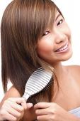 Teenage girl brushing her hair - Asia Images Group