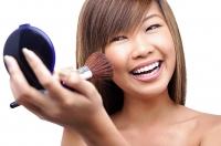 Teenage girl applying make-up - Asia Images Group