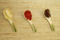 Still life of spices in Chinese soup spoons - Asia Images Group
