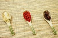 Still life of  Chinese soup spoons with spices - Asia Images Group