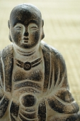 Close-up of small Buddha sculpture - Asia Images Group