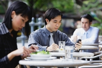 Business people at outdoor café - Asia Images Group