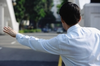 Businessman  flagging a cab - Asia Images Group