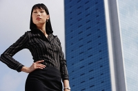 Businesswoman with hand on hip, portrait - Asia Images Group