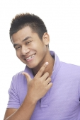 Man smiling, making hand sign - Asia Images Group