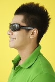 Man in green polo shirt and sunglasses, side view, head shot - Asia Images Group