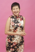 Mature woman in floral dress smiling - Asia Images Group