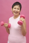 Mature woman with dumbbells - Asia Images Group