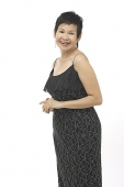 Mature woman in black dress - Asia Images Group