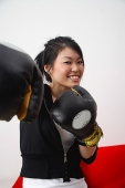 Young woman with boxing gloves - Asia Images Group