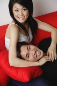 Couple smiling at camera, man lying on woman's lap - Asia Images Group
