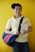 Man with book bag and books - Asia Images Group