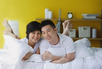 Couple lying on bed, portrait - Asia Images Group