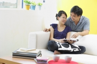 Couple in living room - Asia Images Group