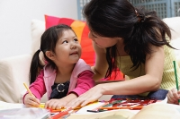 Mother and young daughter drawing at home - Asia Images Group