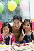 Mother and two daughters, portrait - Asia Images Group