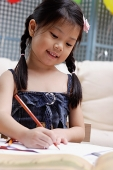 Young girl drawing - Asia Images Group