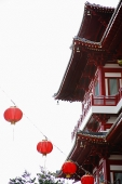 Part of Chinese Temple with red lanterns in front - Asia Images Group