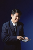 Businessman with calculator - Asia Images Group