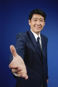 Businessman with hand outstretched - Asia Images Group